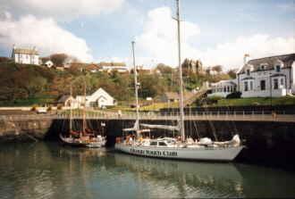 Sunseeker and Black Swan in a corner of Portpatrick Harbour